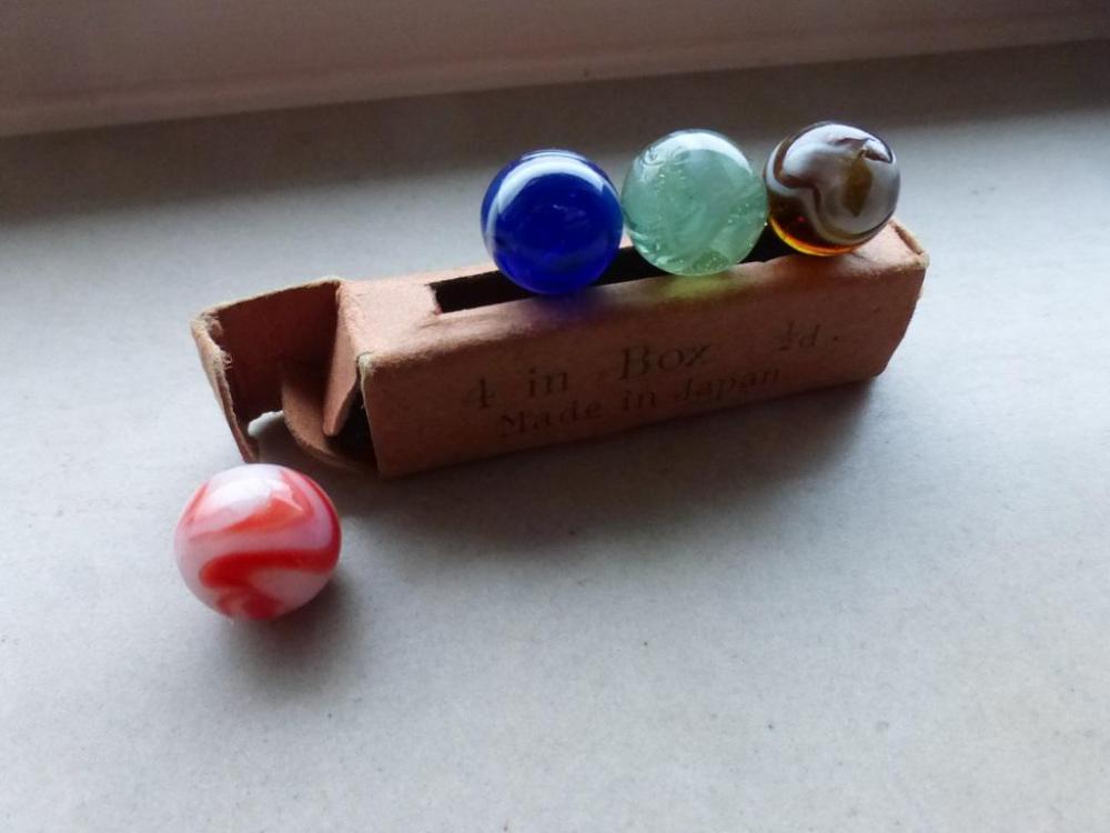 The codeg box of glass marbles (1).JPG